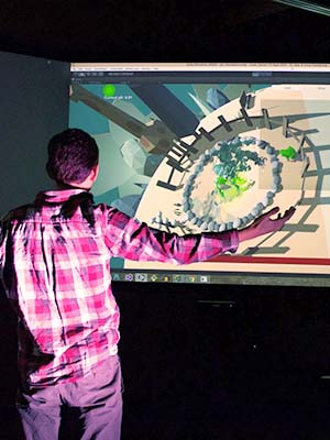 Man gesturing while interacting with simulation